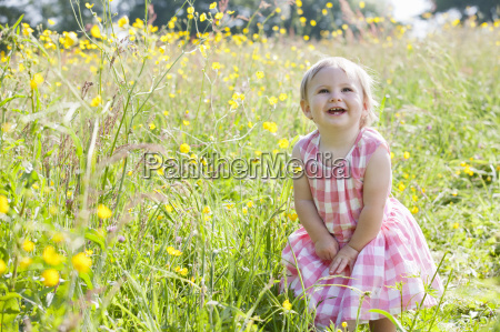portrait of smiling baby in wildflower