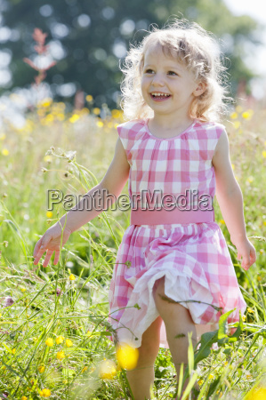 portrait of smiling girl walking in