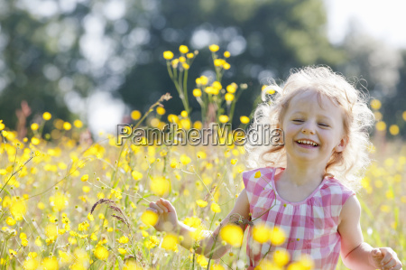 portrait of smiling girl running through