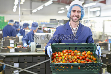 portrait confident worker holding crate of