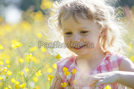 portrait of smiling girl playing in