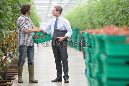 businessman and grower with crate of