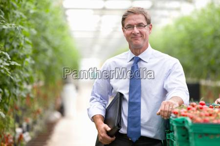 portrait confident businessman at crate of
