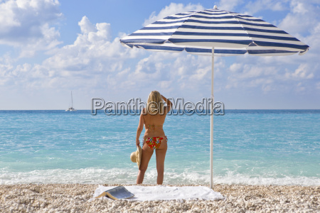 woman in bikini on beach looking