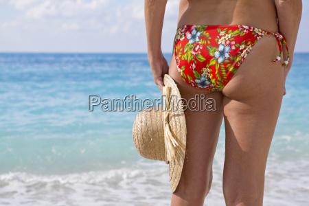 close up woman in bikini holding