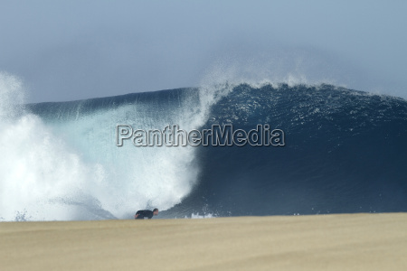 surfing a big wave at the