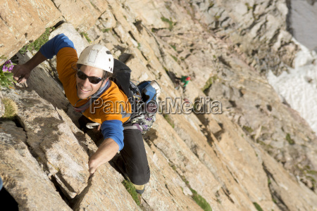 a man rock climbing on the