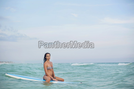 a young woman with a sup