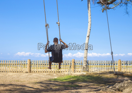 young man on the swings