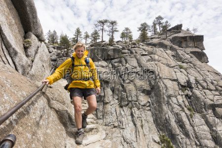 female hiker descending to yosemite falls