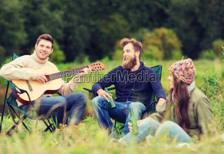 group of tourists playing guitar in