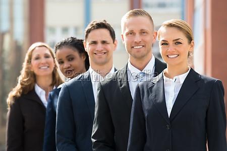 team of businesspeople standing in queue