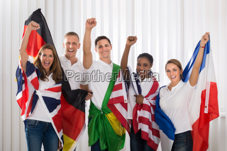 patriotic people with flags from different