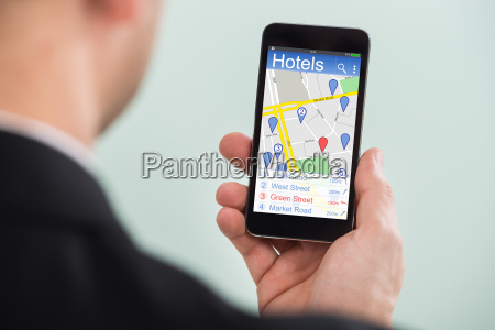 businessman holding smartphone with colorful application