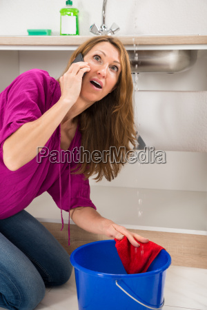 angry woman calling to plumber