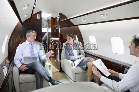 businesswoman and businessmen with digital tablet