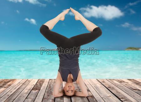 happy young woman doing yoga exercise
