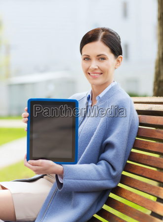 smiling business woman with tablet pc