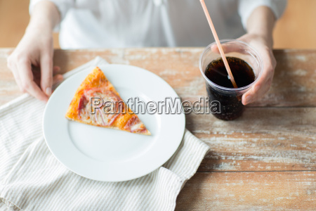 close up of woman with pizza