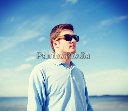 man in sunglasses on the beach