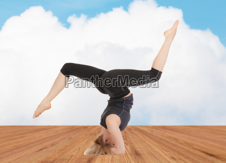 happy young woman doing yoga exercise