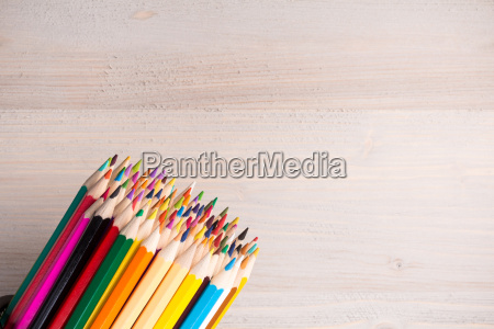 bunch of color pencils on wooden