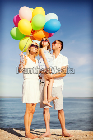 happy family with colorful balloons at
