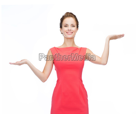 smiling woman holding something imaginary on