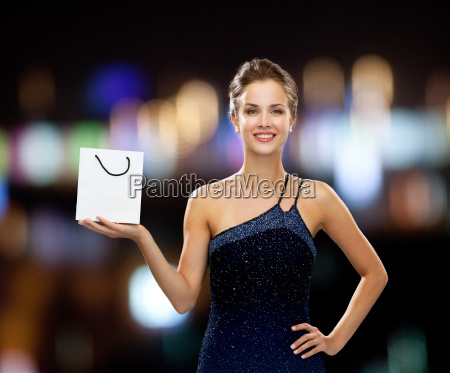 smiling woman with white blank shopping