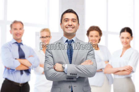 happy smiling business team over office