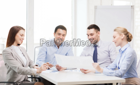 smiling business team having discussion in