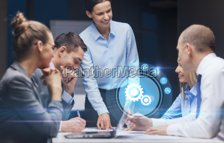 smiling female boss talking to business
