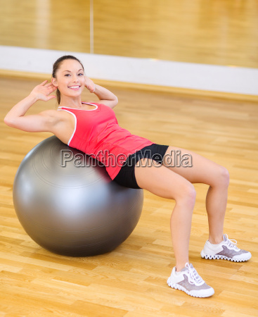young woman doing exercise on fitness
