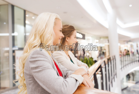 happy young women in mall or