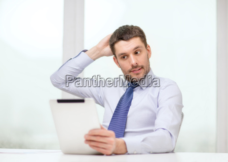 stressed businessman with tablet pc and