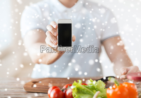 close up of man showing smartphone