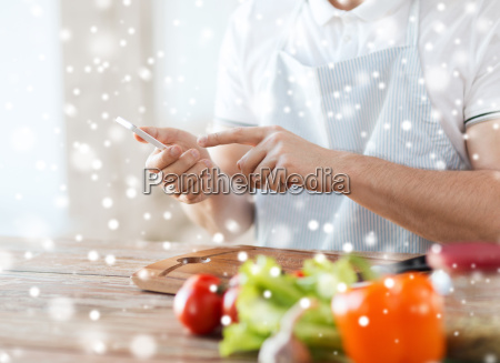 close up of man reading recipe