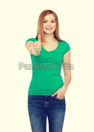 smiling teenage girl showing thumbs up