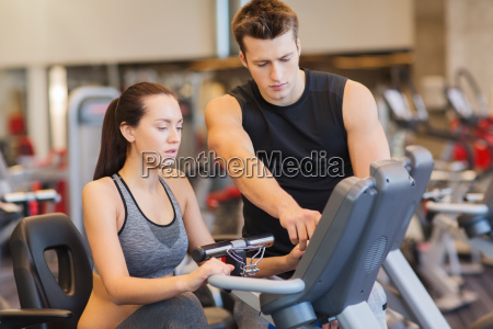 woman with trainer on exercise bike