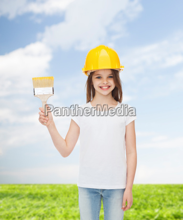 smiling little girl in helmet with