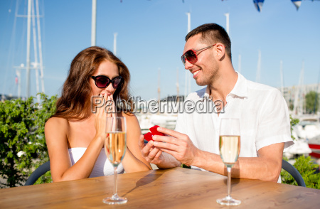 smiling couple with champagne and gift