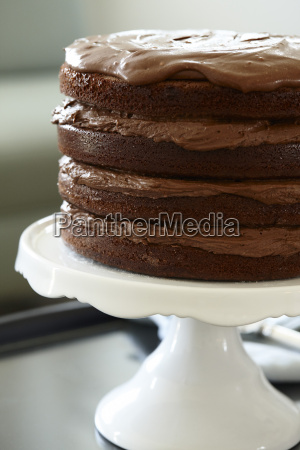 layered chocolate birthday cake on cake