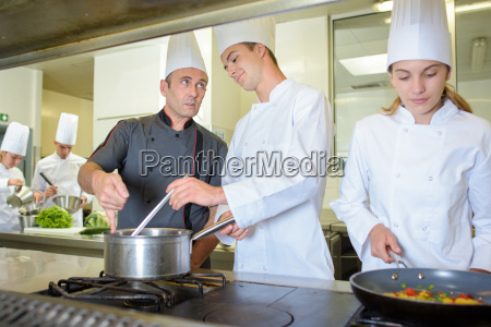 chef advising cookery student