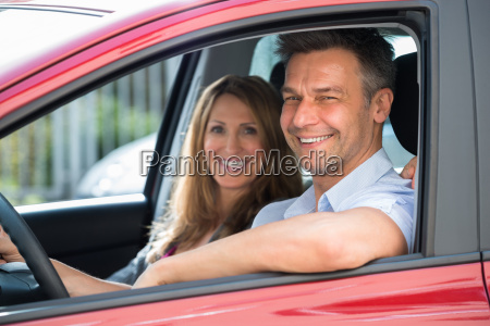 couple sitting inside the car