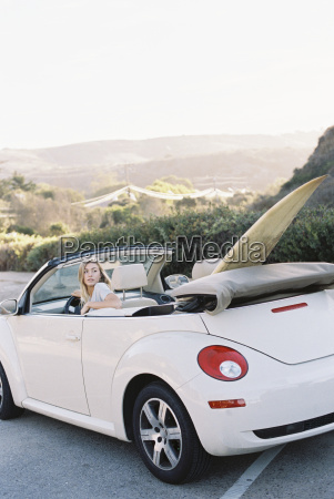 a young woman in the driving
