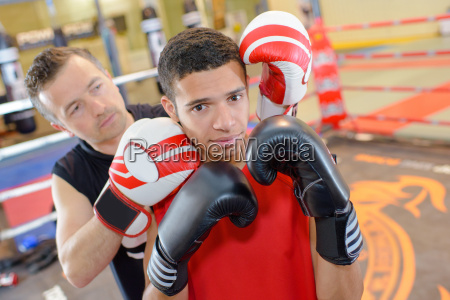 young man with boxing instructor