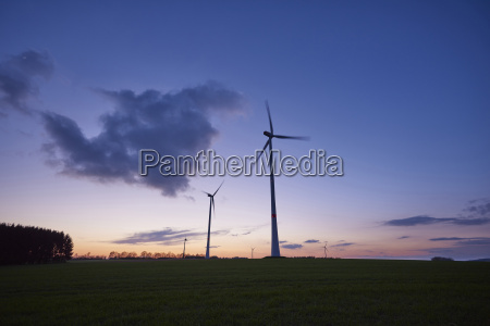 landscape with wind turbines at sunset