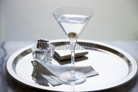 martini with an olive on silver