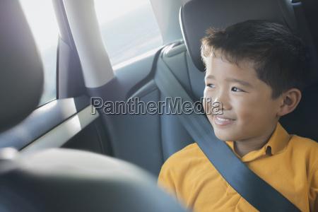 a boy sitting in a car