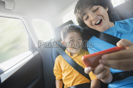 two children travelling in the back